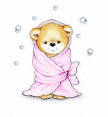 Teddy bear wrapped in pink blanket