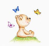 Tenero orsacchiotto e farfalla