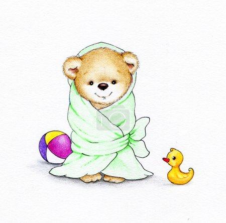 Teddy bear wrapped in blue blanket
