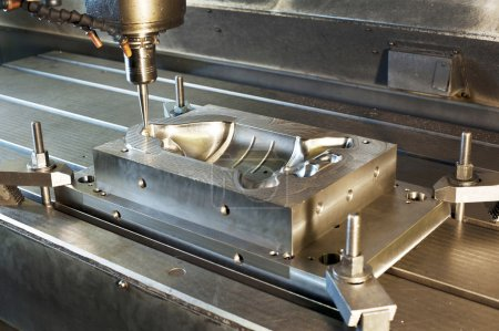 Industrial metal mold milling. CNC technology.