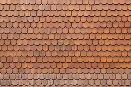 Wooden shingles on house wall