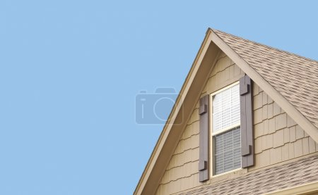 Roof gable with blue sky