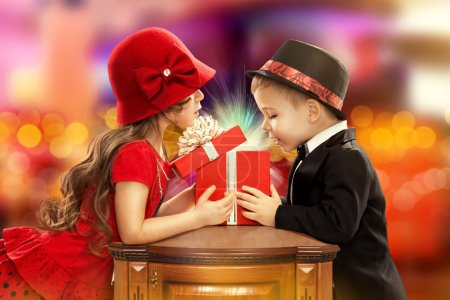 Happy children opening magic gift