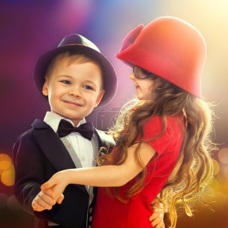 Lovely little boy and girl dancing