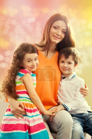 Happy mother with her daughter and son