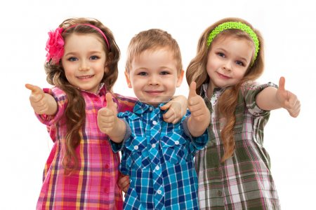 Cute fashion kids showing thumbs up