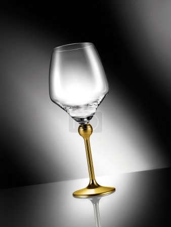 Empty glass with golden stem