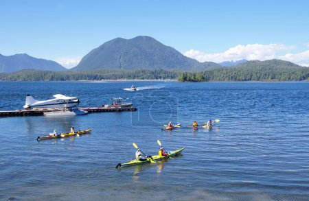 Seaplane, boats and five kayaks in Tofino port Vancouver Island