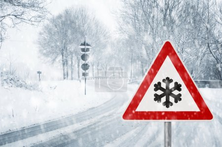 Photo for Snowfall on a country road - Sudden and heavy snowfall on a country road - Driving on it becomes dangerous - Royalty Free Image