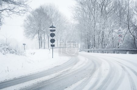 Winter driving - snow on a country road