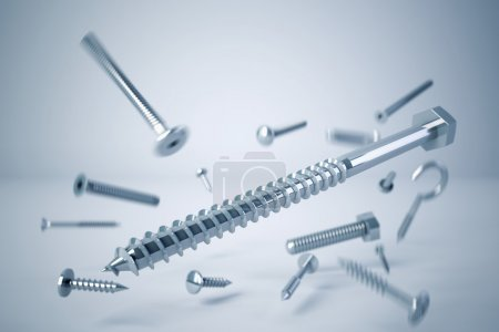 Photo for Various types of screws and bolts caught in drop - Royalty Free Image