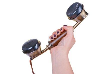 Photo pour Femelle main tenant un récepteur téléphonique vintage. isolé - image libre de droit