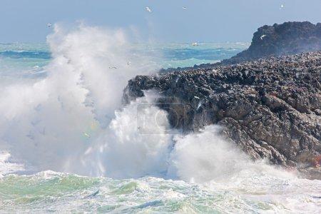 Waves crashing onto a rocky coastline