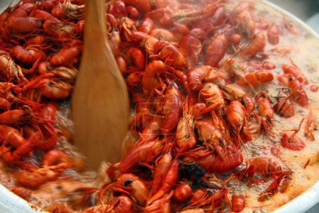 Stirring boiling crawfish