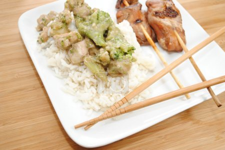 Chop Sticks on a Plate with Chinese Food