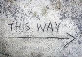 This way inscription  on sand