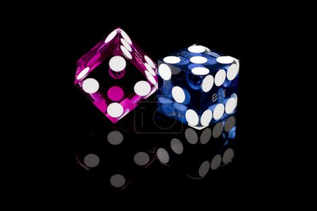 Photo for Colorful casino gambling dice from Las Vegas, Nevada on a black background with reflection - Royalty Free Image