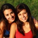 Beautiful multicultural young college women enjoyi...