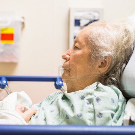Photo for Elderly eighty plus year old woman in a hospital bed. - Royalty Free Image