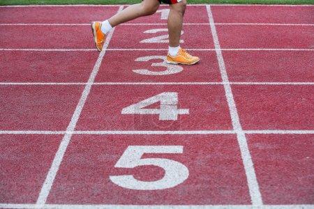 Runner crosses finish line