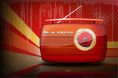 Red vintage radio on retro stripe background with vignetting Vector illustration