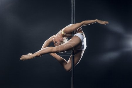 Photo for Young pole dance woman - Royalty Free Image