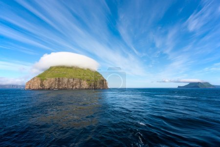 Uninhabited island with a bizarre cap of clouds