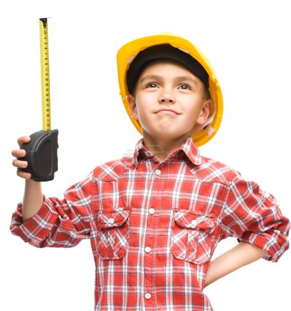 Boy as a construction worker with tape measure