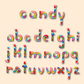 Colored candy alphabet on light background