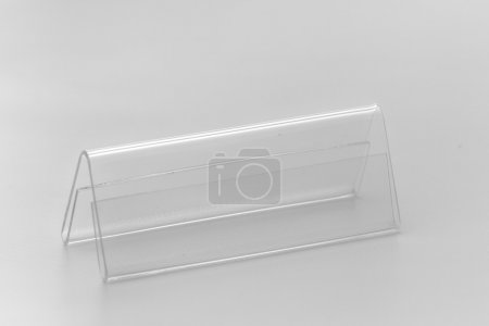 Photo for Acrylic card holder for events. Isolated transparent object on white background - Royalty Free Image