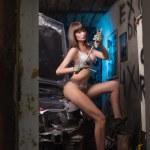 Sexy girl in lingerie car repairs...