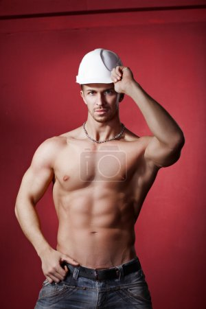 athlete in the construction helmet. working
