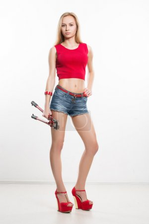 girl in jeans chert. keeps working tools. pliers