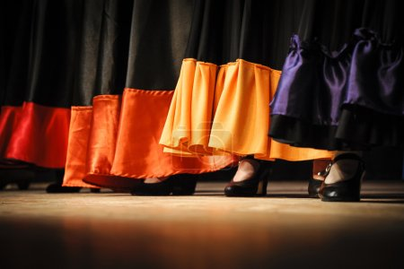 Photo for Flamenco dancers close-up skirts and shoes - Royalty Free Image