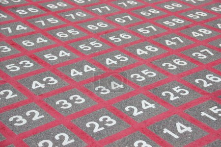 Photo for Matrix on asphalt with white numbers and red lines - Royalty Free Image