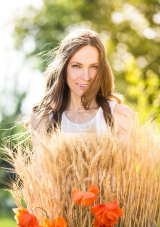 Beautiful smiling woman in a field