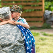 Military man father hugs son. Portrait of happy am...