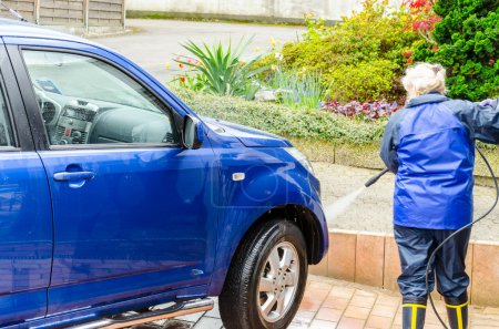 Woman cleans the SUV car manually