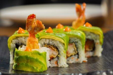 Organic sushi roll with  shrimp tempura at restaurant