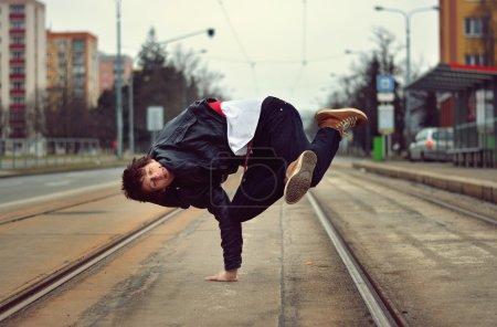 Breakdancer dancing in the city