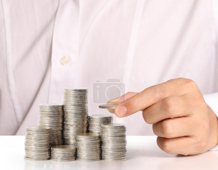 Hand put coin to money