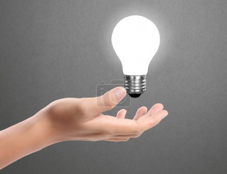 Photo for Ideas bulb light on a hand - Royalty Free Image
