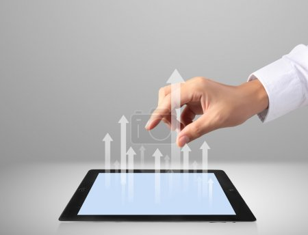Photo for Touch screen tablet with the graph - Royalty Free Image