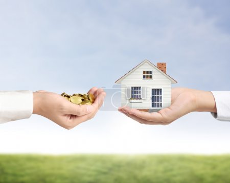 Photo for Holding house representing home ownership and the Real Estate business - Royalty Free Image