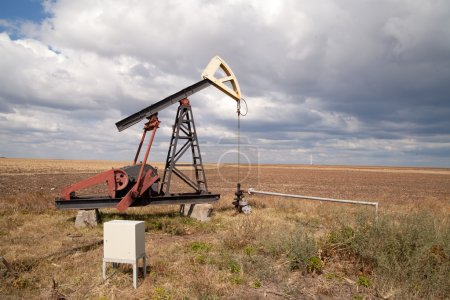 Oil pump, cloudy sky