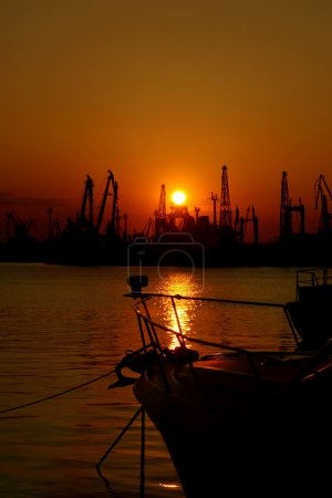 Sunset at the Black Sea coast in Bulgaria. The industrial port of Varna.