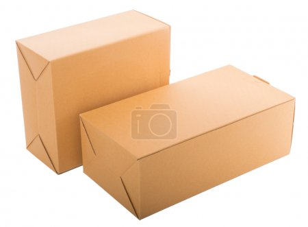 Two closed cardboard boxes isolated over white background