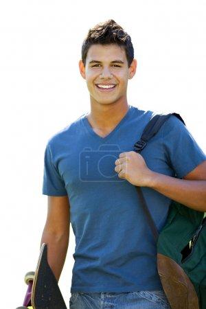 Foto de Estudiante con patín y mochila fuera de la escuela - Imagen libre de derechos