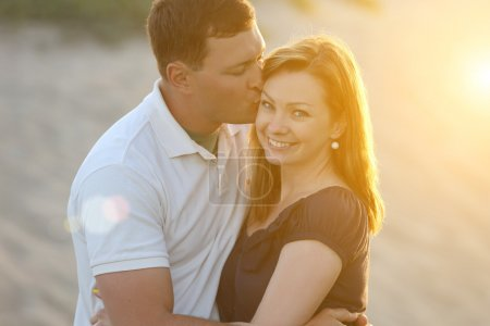 Photo for Happy young couple in love at sunset - Royalty Free Image