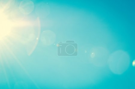 Photo for Sunshine and blue sky with flares in summer - Royalty Free Image